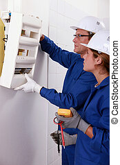 Electrical team installing a fusebox