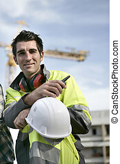 Smiling workman on a construction site