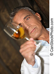 Winemaker examining a glass of wine