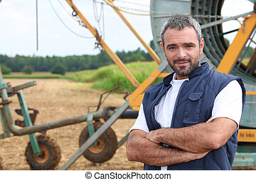 Farmer stood by irrigation system