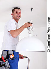 Man fitting light