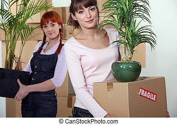 two women moving into a new apartment