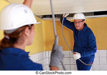 Tradespeople installing a heating system