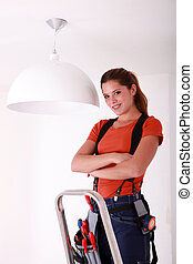 Young woman changing a lamp