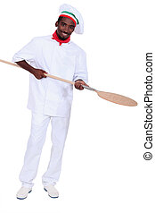 young black pizza cook taking a spade