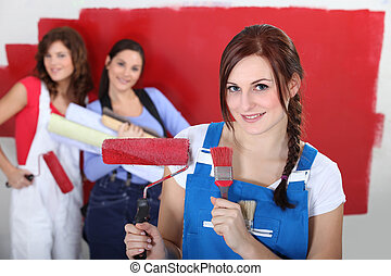 Women painting a room red