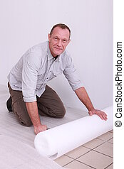 Mover protecting floor with plastic wrap