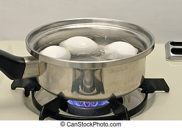Boiling pot of eggs - Eggs boiling in pot of water over...