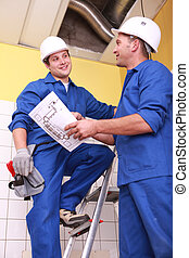 Two electrician repairing ceiling