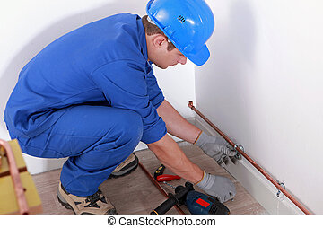 Plumber fitting pipes
