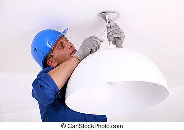Installing the ceiling light.