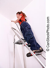 Female electrician doing the wiring