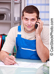 Technician on phone in office