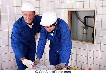 Workers reading a plan