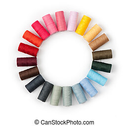 Pile of coloured threads isolated on white