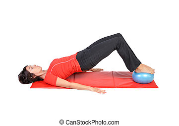 Fit young female pilates instructor showing different...