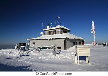Meteorological station in winter - sunny day with blue sky.