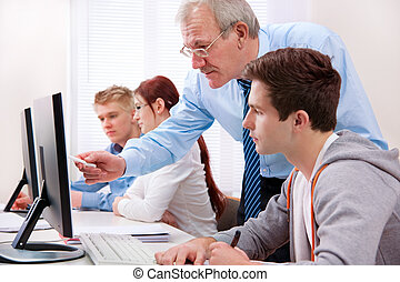 Computer training - Students with a teacher in computer...
