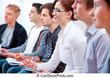Students studying together in classroom - Group of students...