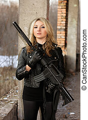 Gorgeous young woman with a rifle