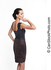 back of Young beautiful sexy woman in brown skirt isolated on white
