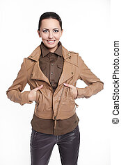 Young beautiful sexy smiling stylish woman in brown jacket isolated on white
