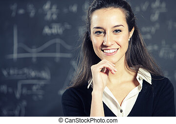 Portrait of a smiling young woman, college student or...