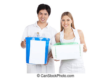 Young Couple Holding Recycle Bin - Portrait of young happy...