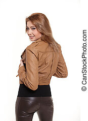 Young beautiful smiling woman in  brown jacket isolated on white