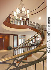 Spiral staircase - Foyer in luxury home with circular...