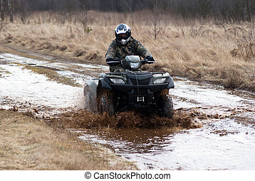 quad - male riding a quad, four wheeler in rural, sport...