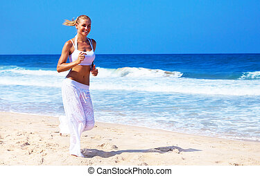 Healthy woman running on the beach, doing sport outdoor,...
