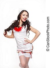 Sexy beautiful smiling female brunette doctor in red lingerie white stocking and red lips on a white background long curly hair