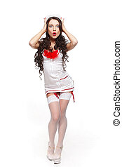 Sexy beautiful surprised female brunette doctor in red lingerie white stocking and red lips on a white background long curly hair