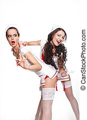 two sexy beautiful  female brunette doctors in red lingerie white stocking and red lips on a white background long curly hair,girl give an injection to another girl