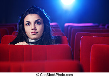 portrait of a pretty young woman at cinema