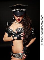 sexy beautiful  brunette semi nude police woman with long curly hair with handcuffs  with birght makeup and red lips isolated on black