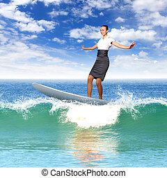 Businesswoman surfing on the sea waves - Image of a...