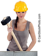 Young woman with a sledgehammer