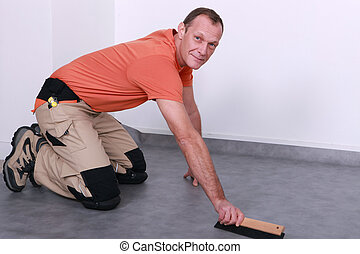 Man fitting new flooring