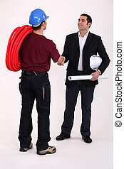 Tradesman and engineer meeting for the first time
