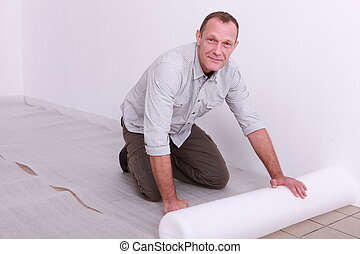 Man putting down underlay