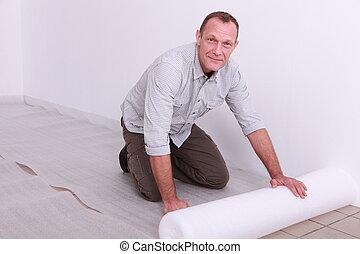 Man putting down underlay