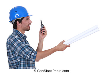 construction supervisor talking on his walkie talkie