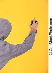 Man about to paint a graffiti.