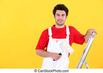 Portrait of a professional house painter
