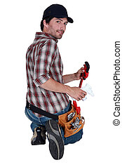 Attractive plumber with a wrench