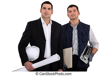 a construction manager and a  worker with a tile cutter
