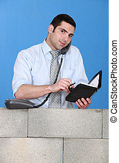 Businessman making an appointment