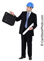 Engineer holding a briefcase and blueprint